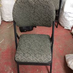 White or beige folding or plastic chair
